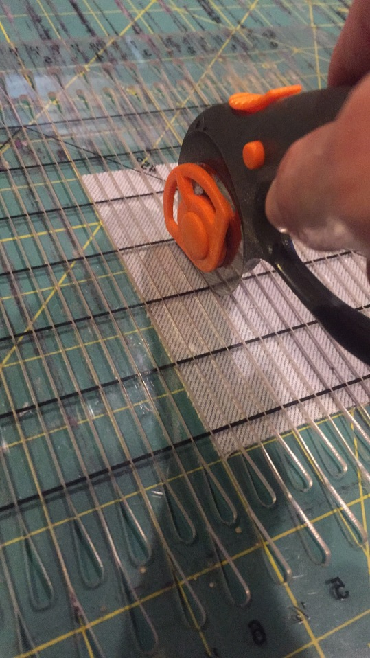 Cutting strips of denim